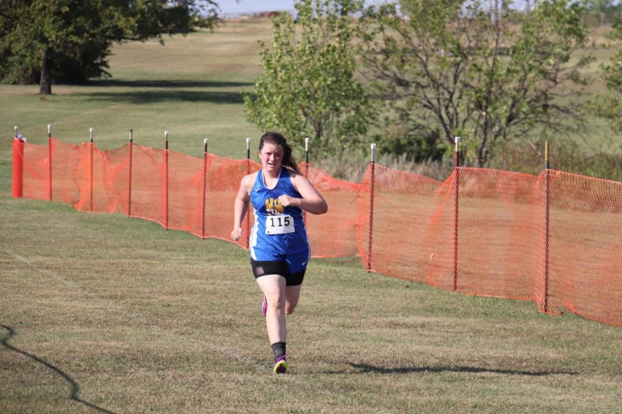 Battling through injuries and the heat, junior Karaleigh Russell approaches the finish line