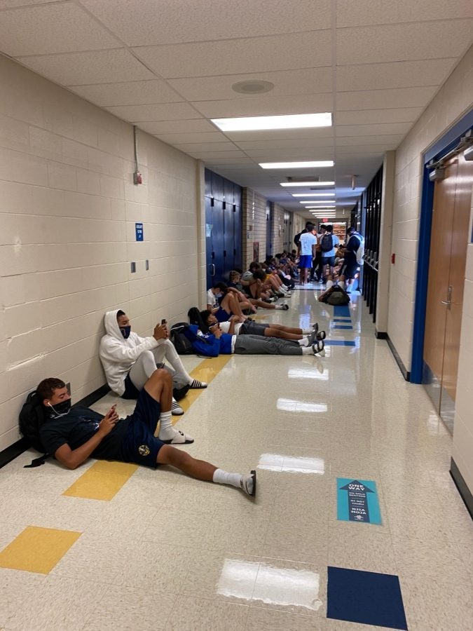 Students kill time in the hallway waiting for practice to begin on Sept. 18.
